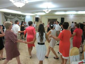 Dancing the Hora is a Moldovan custom where people interlock hands and move in circles together to the music.